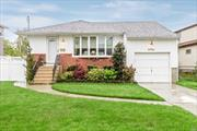 Immaculate Home ! Mid Block Location. All Replaced Windows. Ductless A/C ( 5 Years Old ). Skylight In Eik. 5 Year Old Roof.  Hardwood Floors.  7 Year Old Heating System.  SD #7