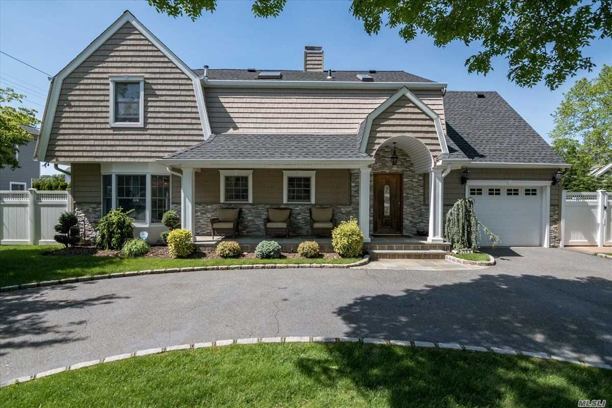 An expanded and Dormered 4 bedroom Colonial in the Carle Place School district a must see !!! Formal Living room with fireplace, Den, Dining Rm, Kitchen, 4 bedrooms, 2.5 baths, Central Air, full finished basement, garage, front porch, built in pool (heated) brick patio, fenced in yard-a must see !! mid block, close to all--amazing house