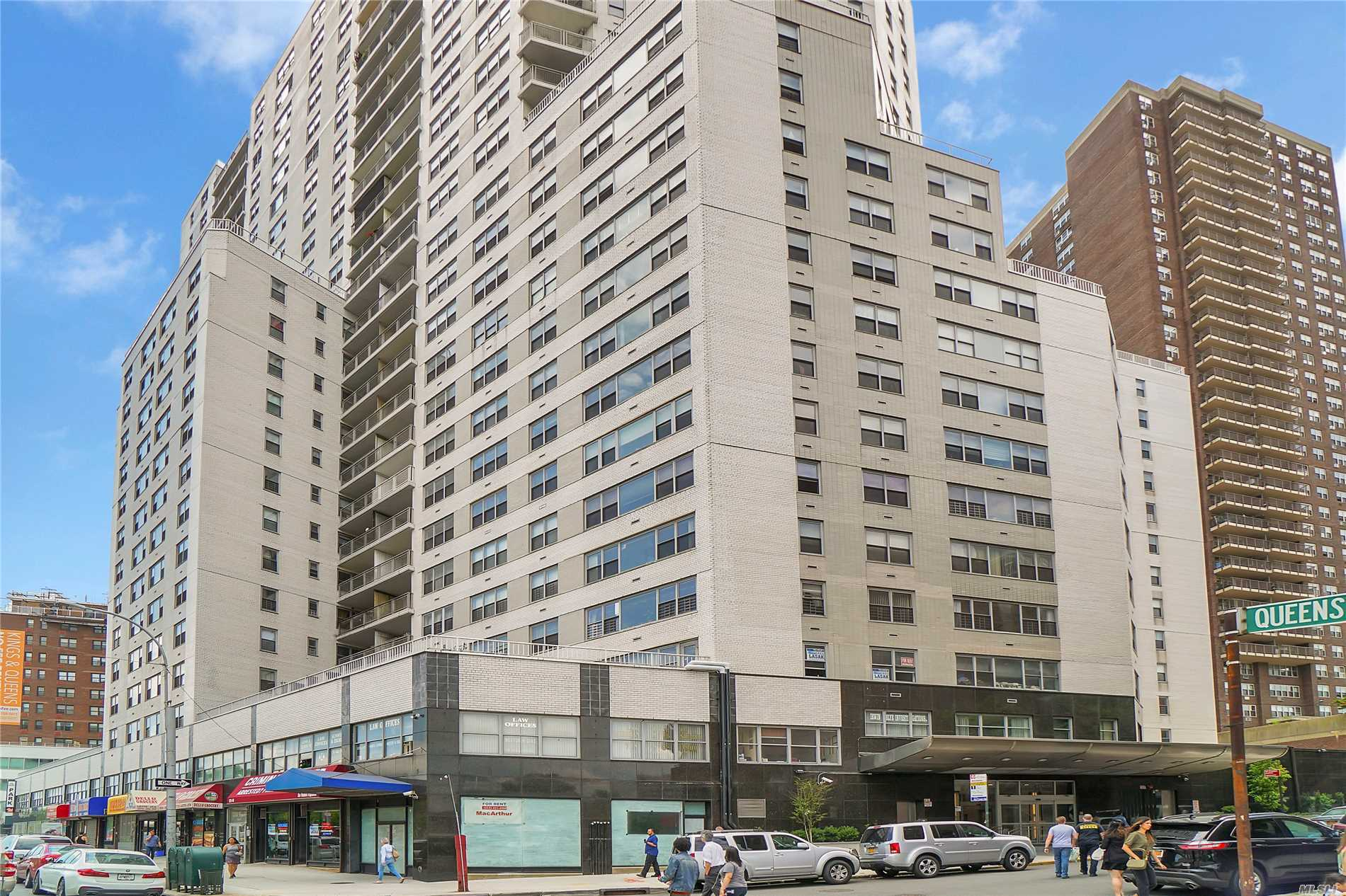 Amazingly large 3 Bedroom 3 Bath apartment, with formal dining and living rooms, lots of closets, corner unit with tons of windows - views galore! Terrace off the living room, stainless steel appliances, eat-in kitchen too! located a block from the E/ F train, 2 blocks to Kew Gardens LIRR Station, across from Courthouse, in the heart of Kew Gardens, close to everything. Rooftop deck with views galore!, private gym. Doorman building!