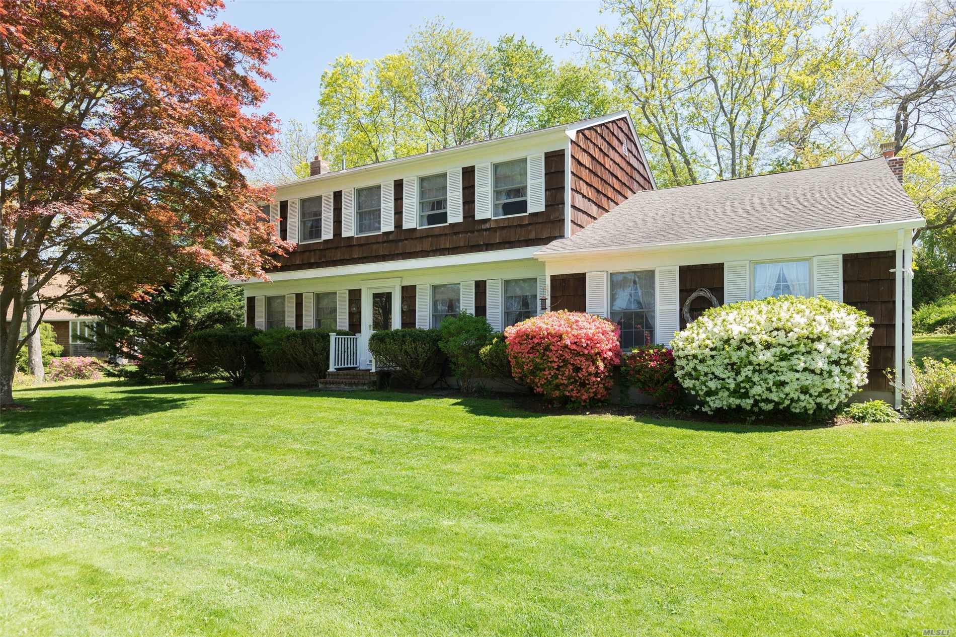 This lovely home sits in a park like setting with mature landscaping offering privacy and lush gardens. Impeccably maintained with wood floors throughout, great living space - perfect for entertaining with large sun filled family room w/ fireplace, formal dining room, oversized living room, four bedrooms with a master ensuite, 2.5 baths, E-I-K. Short distance to Nassau Pt Beach, Pequash, Vineyards, Fine Dining, all things North Fork.