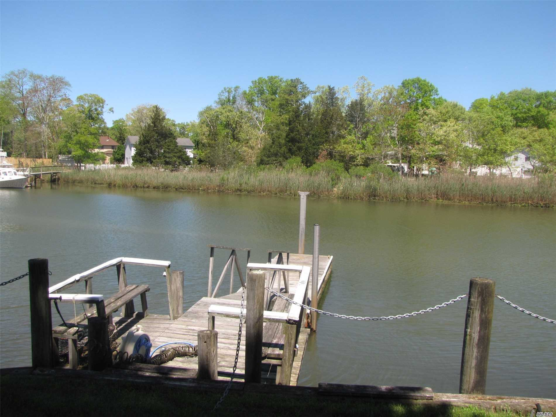 Pristine Waterfront Cottage Renovated 4 Years Ago. Features Open Plan With Quartz Kitchen Counters, New Bath And 2 Bedrooms. Walk Up Attic Ready For Expansion. Deep Waterfront With Dock For Your Yacht. Just Listed In Time For Summer Enjoyment $699, 000.