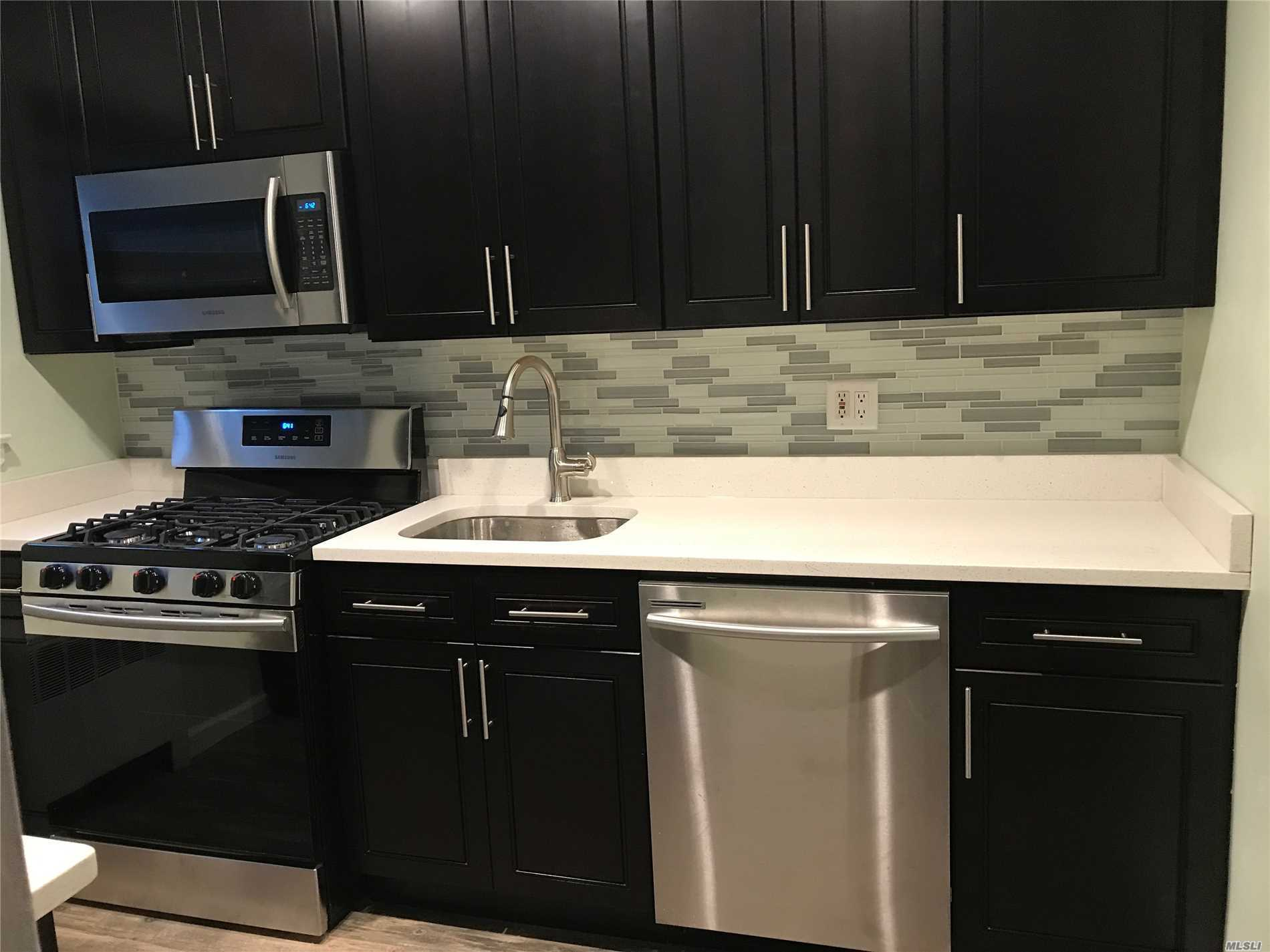2 Bedroom Lower Garden Beauty Featuring Renovated Bath With Porcelain Tile, Fully Renovated Kitchen With Stainless Steel Appliances And Granite Counter Tops, Beautiful Hardwood Floors, Corner Unit with Additional Windows,  Pets Ok! Private Entrance, Close To Shops and Transportation, Can Sublet After 2 Years