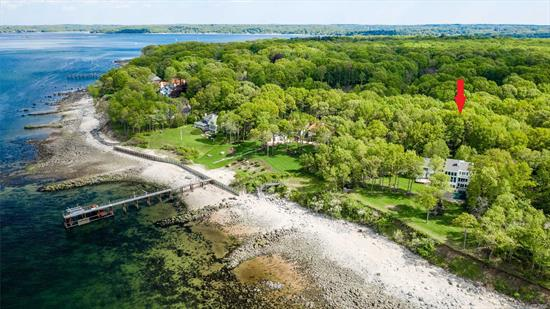 Dramatic waterfront property custom built in 2001 & privately in Seacrest Estates w/ breathtaking views of the LI Sound & Connecticut. This exquisitely designed home offers an exceptional open floor plan featuring a two story great rm with floor to ceiling windows that overlook the spectacular two acre property. Custom Center Island Kitchen Walk out lower level w/theater and great rm. Expansive entertaining rear yard. Village beach, mooring & tennis w/dues