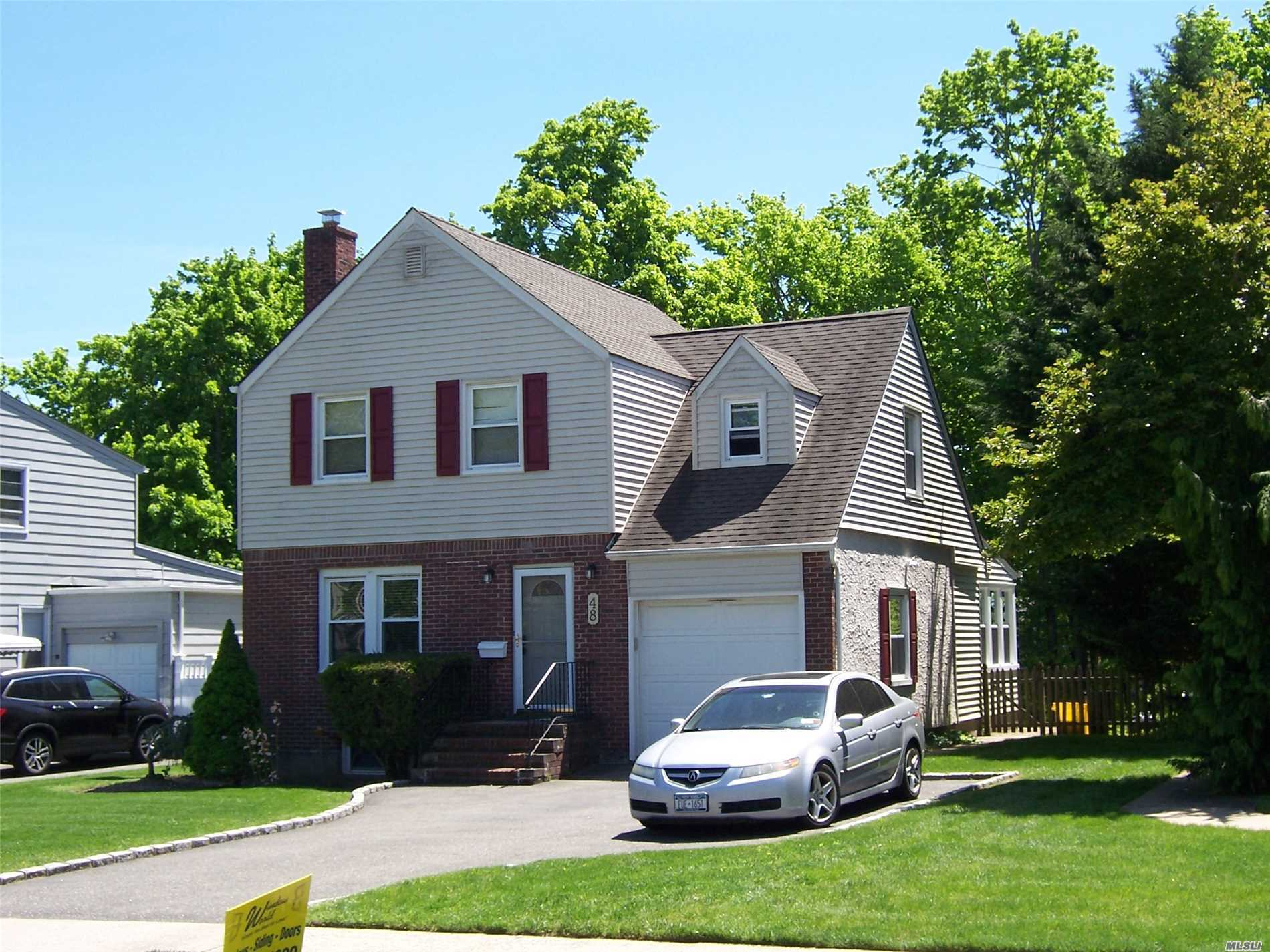 Beautiful Lenox Hills. Updated & Extended Colonial. Lg. Park like Property. New EIK with Cherrywood Cabinets. Silestone Counter Tops. Tiled Flrs, Gas Cooking. SS Appliances, Hi-Hats, Sliding Door to Trex Deck. Brand New 2 Zone Gas Heating and New baseboard.. New 50 gal. Sep. Hot Water Heater.Refinished and Stained Hardwood Flooring Through-out. New and Updated Windows. Arch Roof. Close to Train, Golf Course, and Farmingdale Town Village and Parkways.