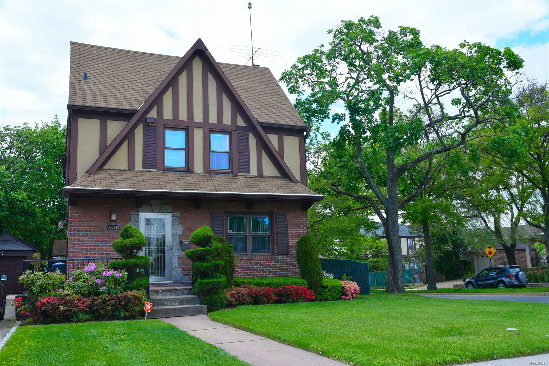 Location! Location! Location! This Brick corner colonial house right in the heart of Fresh Meadows, and situated only one block away from Union Turnpike and all shopping and transportation. House is in excellent move-in condition, very well maintained and have an updated heating system and hot water heater. Roof is also has been partially updated four years ago. Won't last!.. Call today for your private showing...