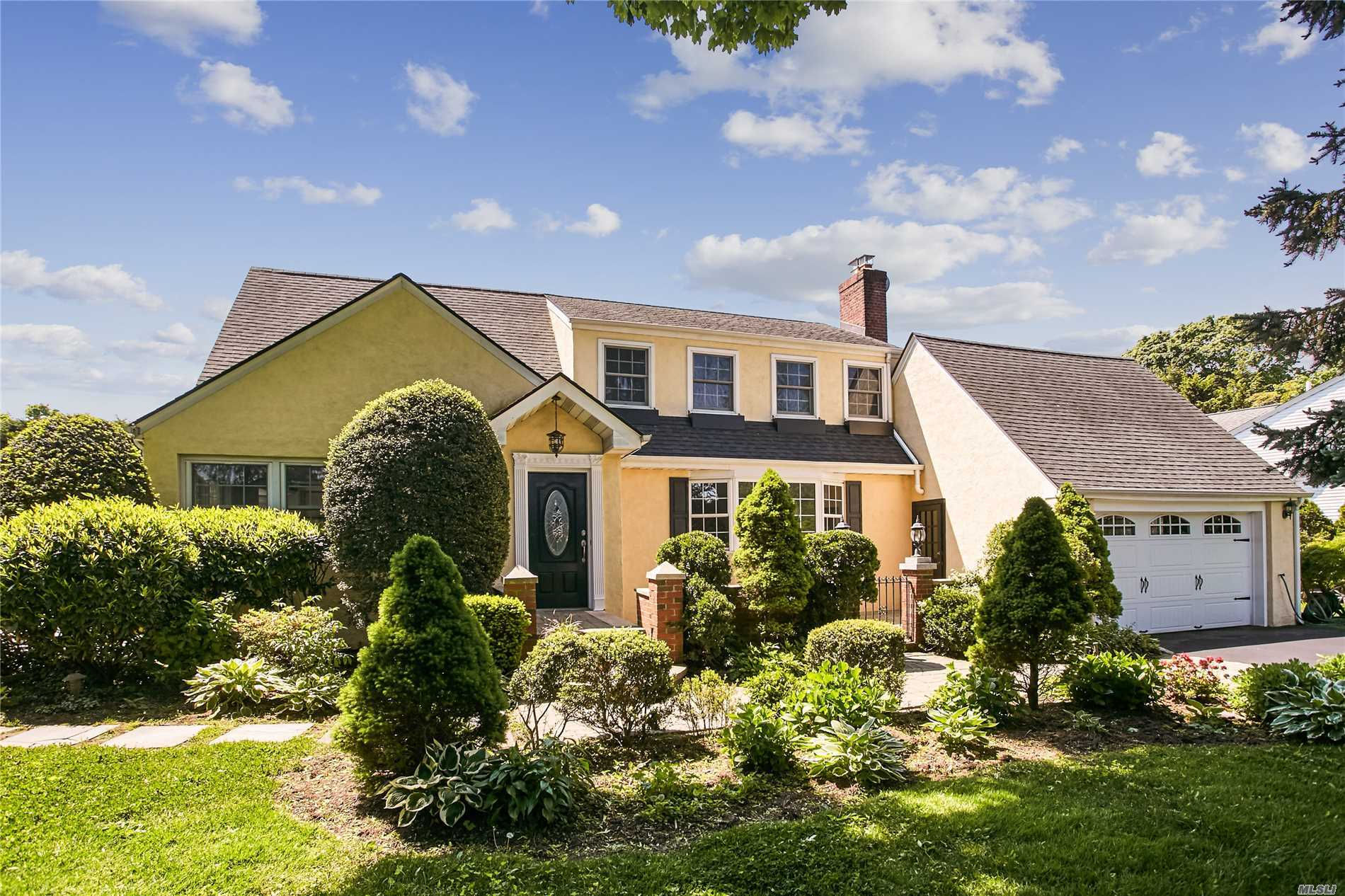 Step inside this wonderful Colonial home with 5 bedrooms and 4 baths set on beautiful landscaped property. The first floor offers EIK, Drm, Lrmw/fplc, frm w/fplc, full bath and bdrm. The 2nd floor has Mbdr w/fbth, 3 bdrms and 2fbths with rad heat. This updated home includes CAC, upgraded electric, private yard, IGS, harwood floors, crown moldings and finish basement. Convenient to parks, schools, LIRR, Library and town pool. East Williston Schools