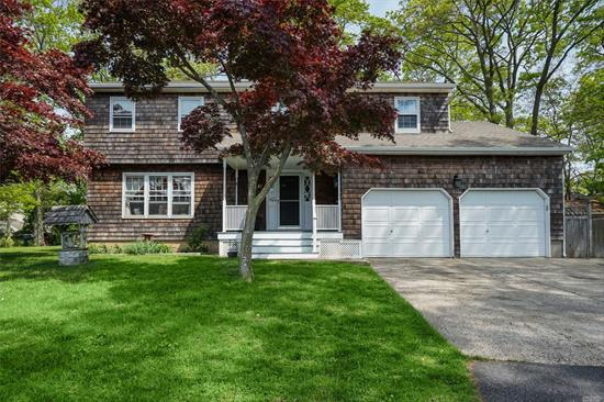 First time on the market! This custom Colonial is exceptionally well built and offers plenty of space. Enjoy casual gatherings in the family / entertainment room which boasts a bar, fireplace and outside entrance to the backyard. The formal living room offers abundant sunshine all day. Clean, new carpet and freshly painted, this home is ready for your updates. Rocky Point Schools and convenient to all!