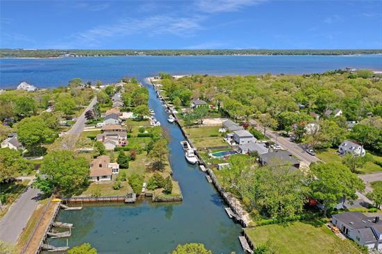 Boater's paradise! This 3 Bedroom 2 Bath home is ready to move in. The lower level has a den with a fireplace. The home is on a recently restored deep water dock leading to the Peconic Bay. If you are not in the mood to go boating, walk to the private beach! Grab one of the last affordable pieces of waterfront in the Town of Southampton!