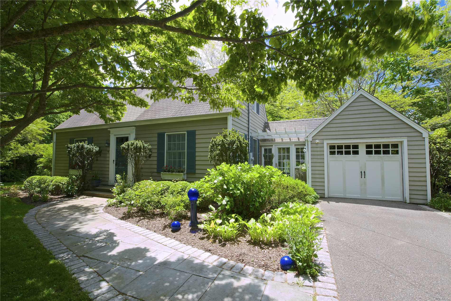 Well maintained cape on quiet, tree-lined street, hardwood floors through out, state of the art kitchen with marble countertops, sun room with radiant heated floors, gas fireplace.