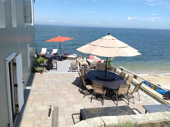 Rare opportunity to own a completely renovated 4 bedroom 4 bath Soundfront property with 180 degree views. This home was finished with the highest quality materials. It features an open floor plan with huge picture windows in the living room. Waterfront living doesnt get any better when you step out onto the expansive deck that wraps around the house. Step off the deck and onto the sand and enjoy your own private beach. It is a perfect house for entertaining and is completely move-in ready!