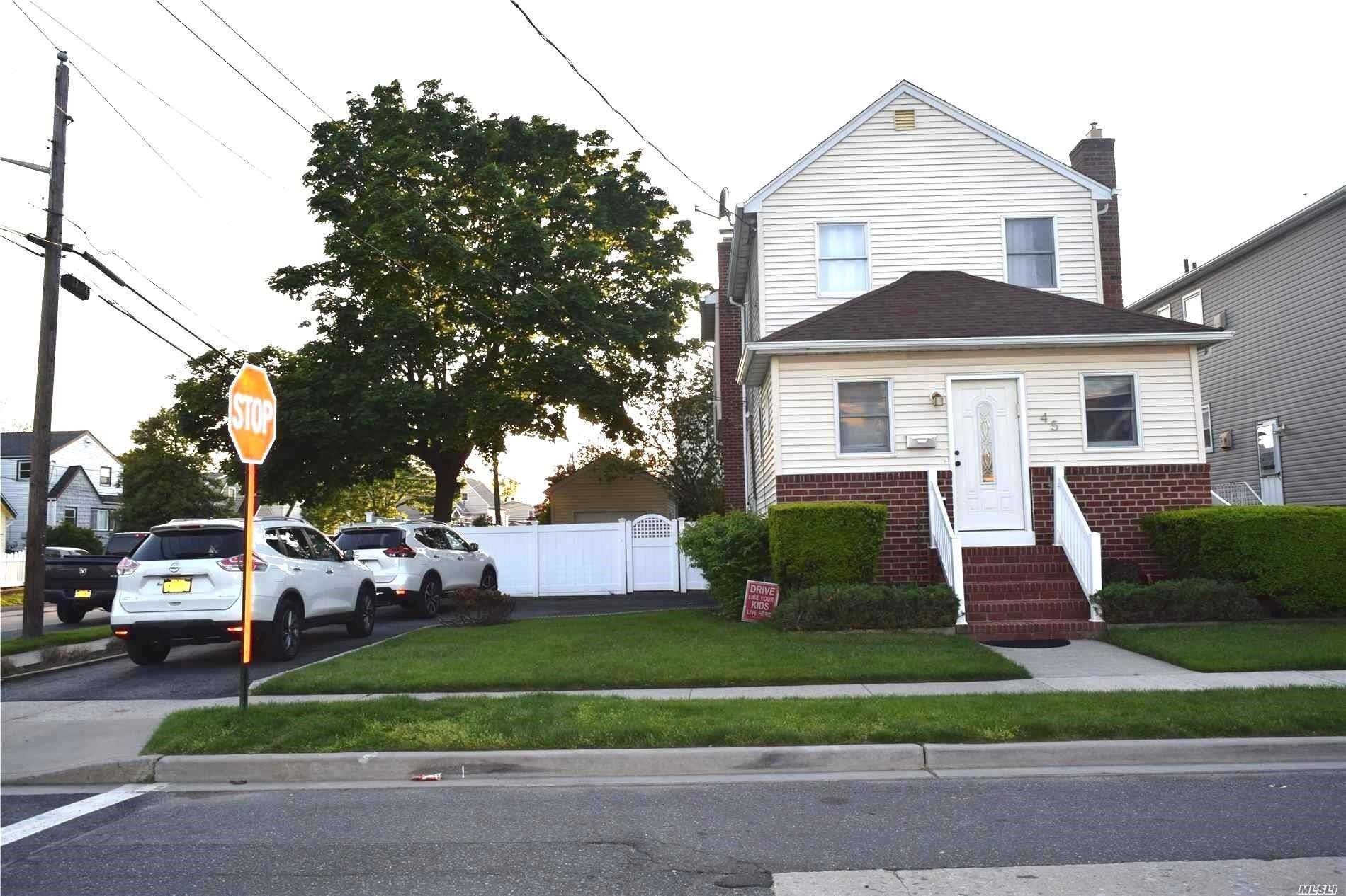 Beautiful Side Hall Colonial In The Heart OF Bay Park. Foyer, Lr, Formal Dr Updated Kitchen, 3 Nice Sized Br, 2 Bath. New Floors. Updated Electric. Inground Sprinklers & Rear Deck. Close To All Transportation!