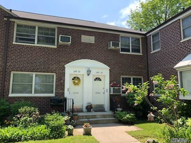 Spacious corner unit with lots of natural light. Living room/dining room, updated kitchen with washer/dryer and nice counter space. Large bedroom with double closet. Plenty of attic space for storage. Lovely, small courtyard setting.