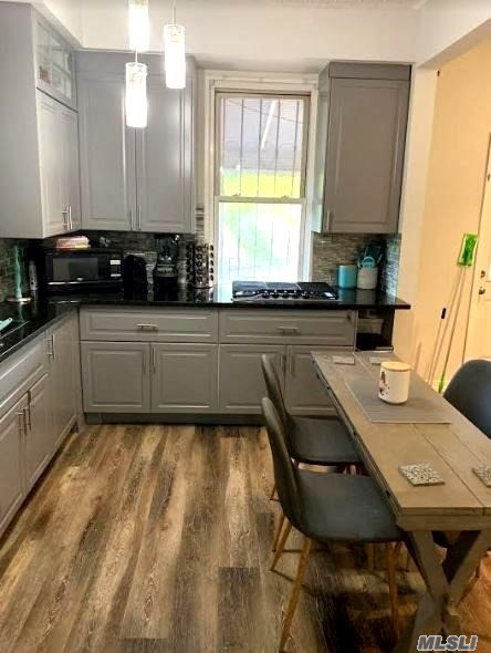 All Renovated Apartment For Rent In Maspeth, Features Open Concept Dining Room/ Living Room w/ Balcony, Eat In Kitchen W/ SS Appliances, Spacious Bedroom & 1 Full Bath. Hardwood Flooring Throughout. All Utilities Included. Ample Street Parking. Close To Shops & Transportation. Wont Last!!