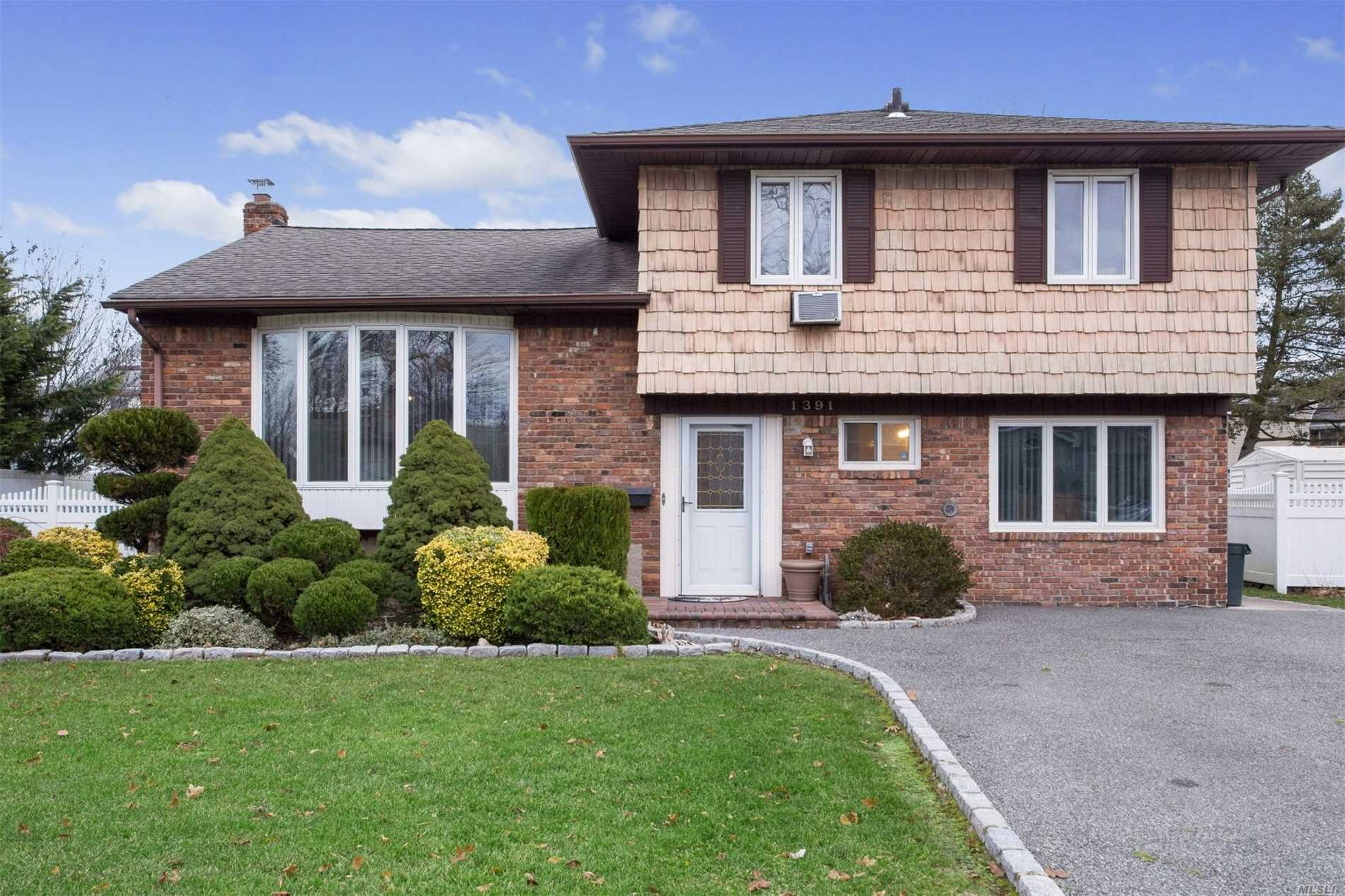 Welcome to this 3 Bedroom Oversized Split Featuring Hardwood Floors, An Open Floor Plan With Large Oversized Island In Kitchen, Living Room & Dining Room, Sunken Den With Large Fireplace, Office On Main Level With .5Bath, Upgraded Electric, Plenty Of Storage, Finished Basement, Beautifully Landscaped with Deck and Privacy and Disirable Wantagh Schools-Forest Lake Elementary.
