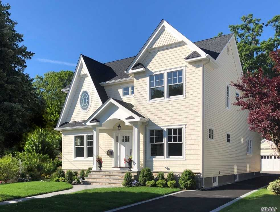 New Elegant & Spacious 4 Br, 2.5 Bath Includes Welcoming Cathedral Entry Hall, Lg FLR, FDR, State-Of-The-Art Designer Kit W/Butlers Pantry, Leading Edge Applcs, Fam Rm W/Fplc, Mud Rm, Mstr Suite W/Lg.WIC, Marble Mstr Bth W/Radiant Heat. Substaintial Moldings, Built-Ins, Shiplap, Coffered Ceilings, Raised Paneling, Siding, Windows & More. Large Backyard & Garage For Your Outdoor Pleasure!