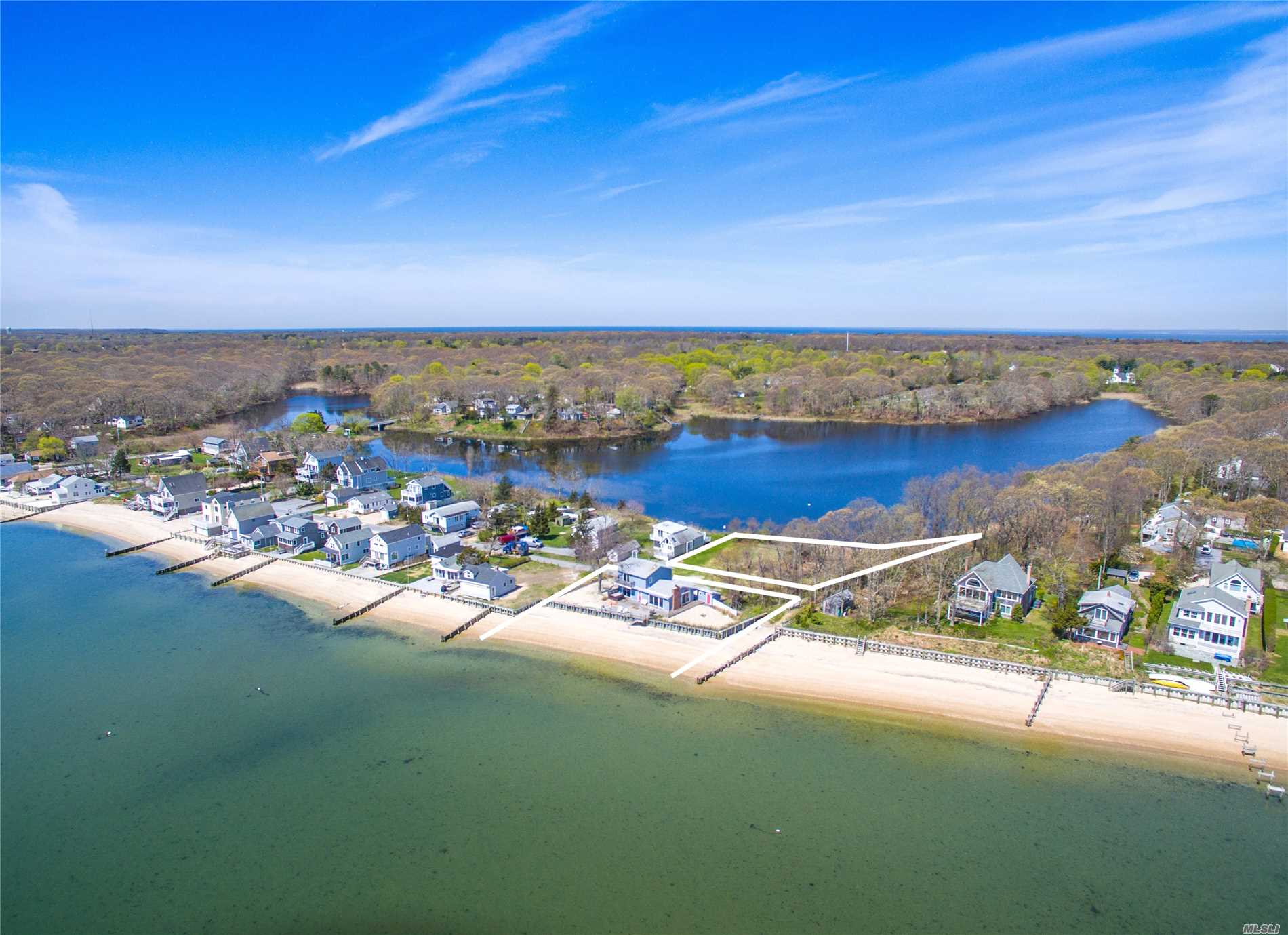 Beautiful Bayfront Home Within Quintessential North Fork Beach Community. Property Features 273' of Waterfront Between Gardners Bay & Lake Marion. Lower Level Offers 2 Beds, 1 Full Bath, Hwood Floors, Open Living Area Including Kitchen, LRoom & Dining Room Along w/ Walkouts To Mahogany Deck Leading To 100' Of Sugar Sand Beach. Upper Level Offers 1 Full Bath, Laundry Room & Master Bedroom w/ Unobstructed Views Of Lake Marion & Gardners Bay! Sale Includes Two Lots (1000.31.17.19) (1000.31.18.18)