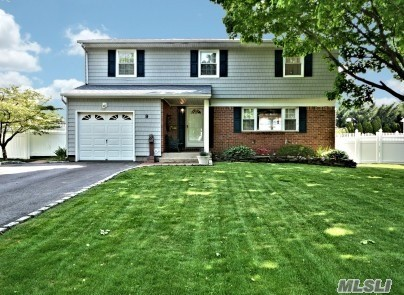 Lovely, well-maintained, move-in ready expanded Colonial on quiet tree-lined street w/sidewalks. Beautifully landscaped, flat PVC fenced .25 acre w/heated 16'x34' IG pool/new loop lock cover. Freshly painted neutral interior, Den/sliders to patio, 4 bedrms (4th used as dressing rm w/WIC), 2 full baths, EIK w/Corian counter & oak cabinets, HW & ceramic tiled floors, 6 panel pine interior doors, hi hats, crown molding.New front vinyl siding, new Belgian block lined driveway, Town beach rights.