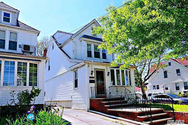 Stately Detached colonial. Fully renovated, modern kitchen, bright and large living room, house has a beautiful basement with a separate entrance. In Noble district enjoy exquisite living and high rent. Two sets of boiler heating equipment, Close to transportation, stores and restaurants...