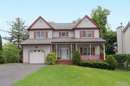 This YOUNG 4 BR/2.5 BTH Colonial is near Huntington & Cold Spring Harbor. The front porch leads to a large Entry Foyer, The EIK has wood Cabs/granite/updated appliances and opens to Den/FPL&Vaulted Ceiling, Formal LR & Dr, entire main level has hardwood floors. The 2nd floor has master BR/tray ceiling & spa bath, 3 addl BRS, full bath and laundry. Full, Fin. basement has high ceilings and plenty of storage. GAS heat & Cooking! Taxes being GRIEVED!!! OWNER OFFERS $5, 000 CREDIT TOWARD TAXES