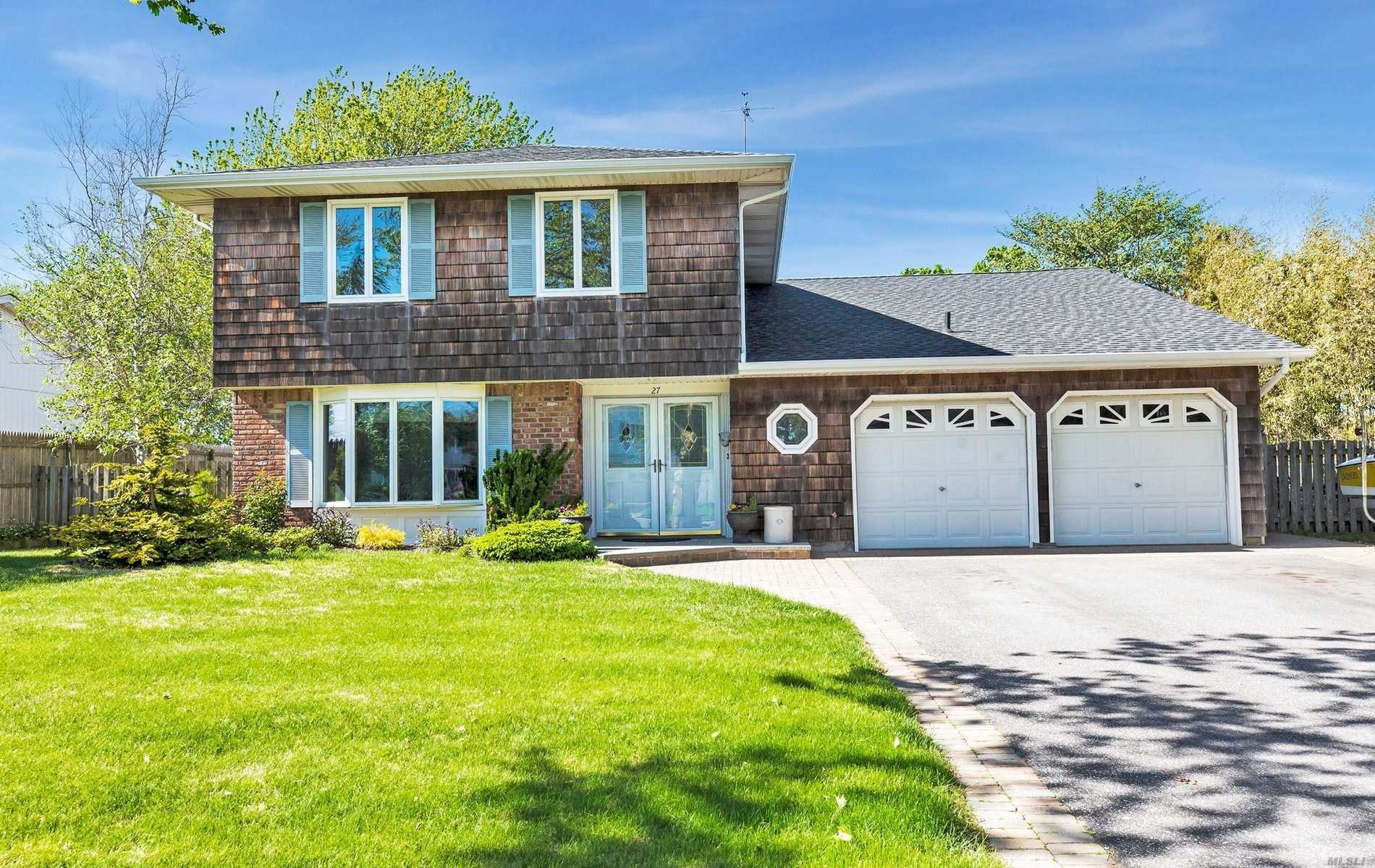 Renovated Waterfront Colonial Splanch w/2, 214 SF + 2-Car Att 460 SF Garage.EH w/Coat Closet, Half Bath & Entry Into Garage, Formal Dining Room, & Open Eat-in-Kitchen & Den w/Fireplace. 2nd Floor has the Living Room w/French Doors to Deck. Top Floor has Master Bedroom w/MBth, 3 More Bedrooms & Full Bath. Part Bsmt w/Laundry/Boiler Area. Radiant Heat Throughout 1st Fl. Gas Heat, Radiant Floors, 80' Bulkhead. No Flood Insurance Needed.