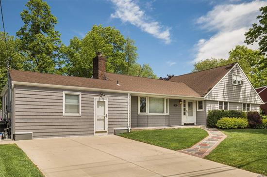 Wide-line expanded ranch on 100x100 lot with 6 bedrooms, 4 bathrooms and plenty of room to expand up and out. Prime Woodmere SD#15 location. Master bedroom on 1st floor.  Massive yard, gorgeous curb appeal, many upgrades. Architectural plans for expansion included in the sale.