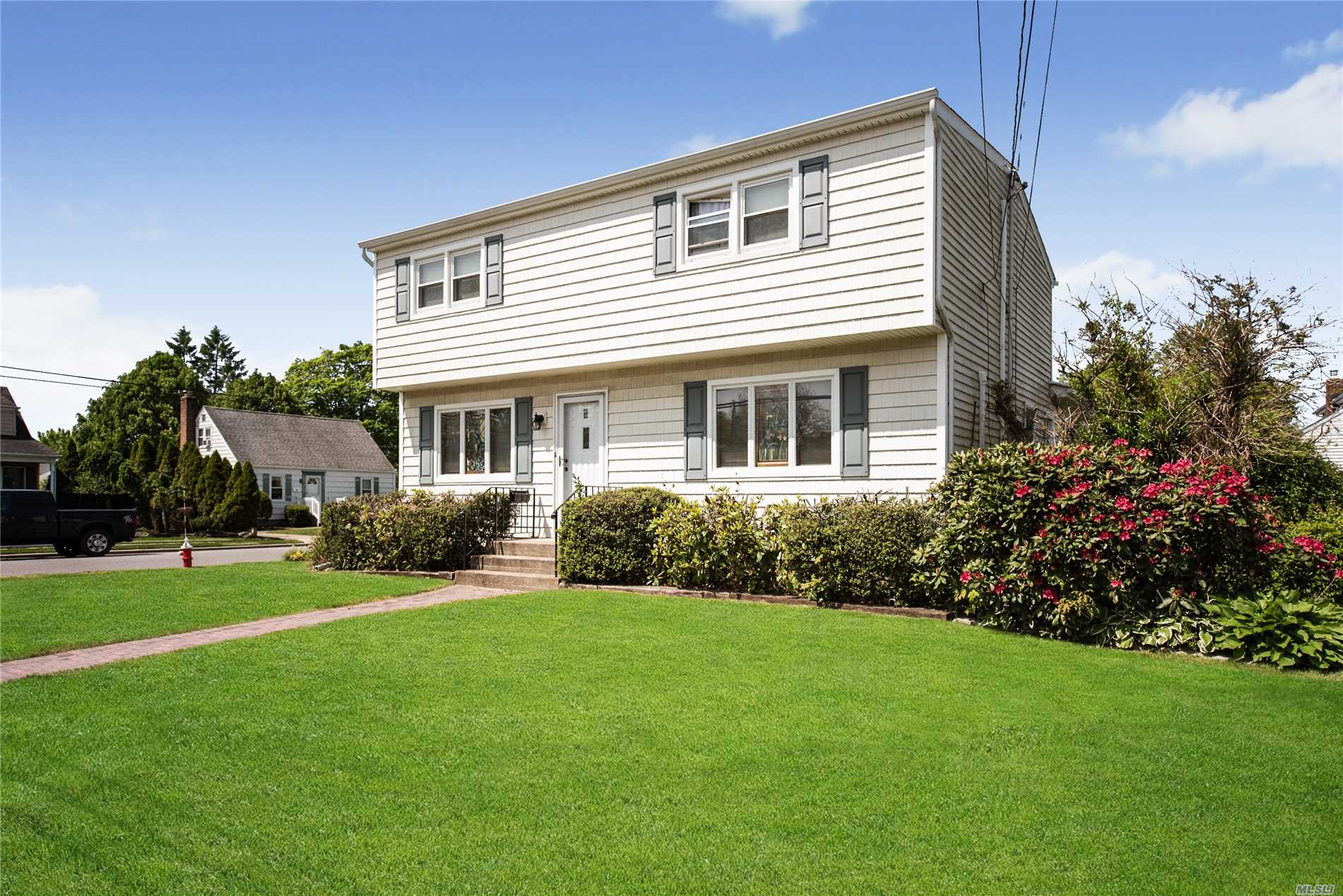 4 Bedroom, 2 Bath Large Colonial Situated on a Beautiful Private Court.  Very Large Master Bedroom, Formal Dining Room, Living Room, Family Room, Finished Basement, Bethpage Schools.