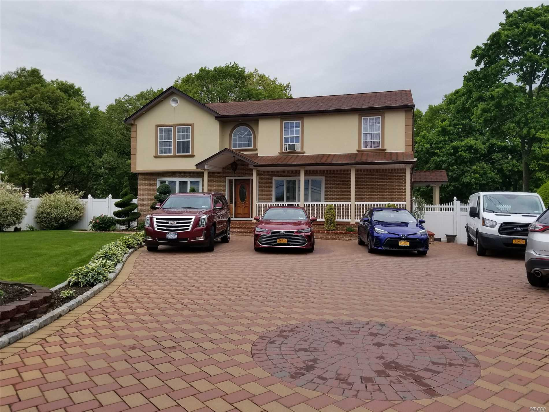 don't miss this beautiful colonial , SS appliances granite floors in hallway and kitchen, wood thru out, finished basement with separate entrance possible mother and daughter with permits , 2nd floor 4 large bedrooms and 2 full baths