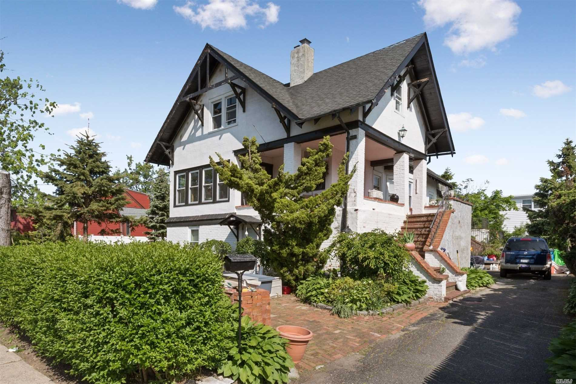 Beautiful home with old world charm. Come see this one of a kind Oak Chalet. Featuring sun drenched huge eat-in-kitchen with double stoves. Mstr. Bedroom Suite, Library. Open Formal Dining/Living Room Area. Nothing like it on the market. Sold As Is.