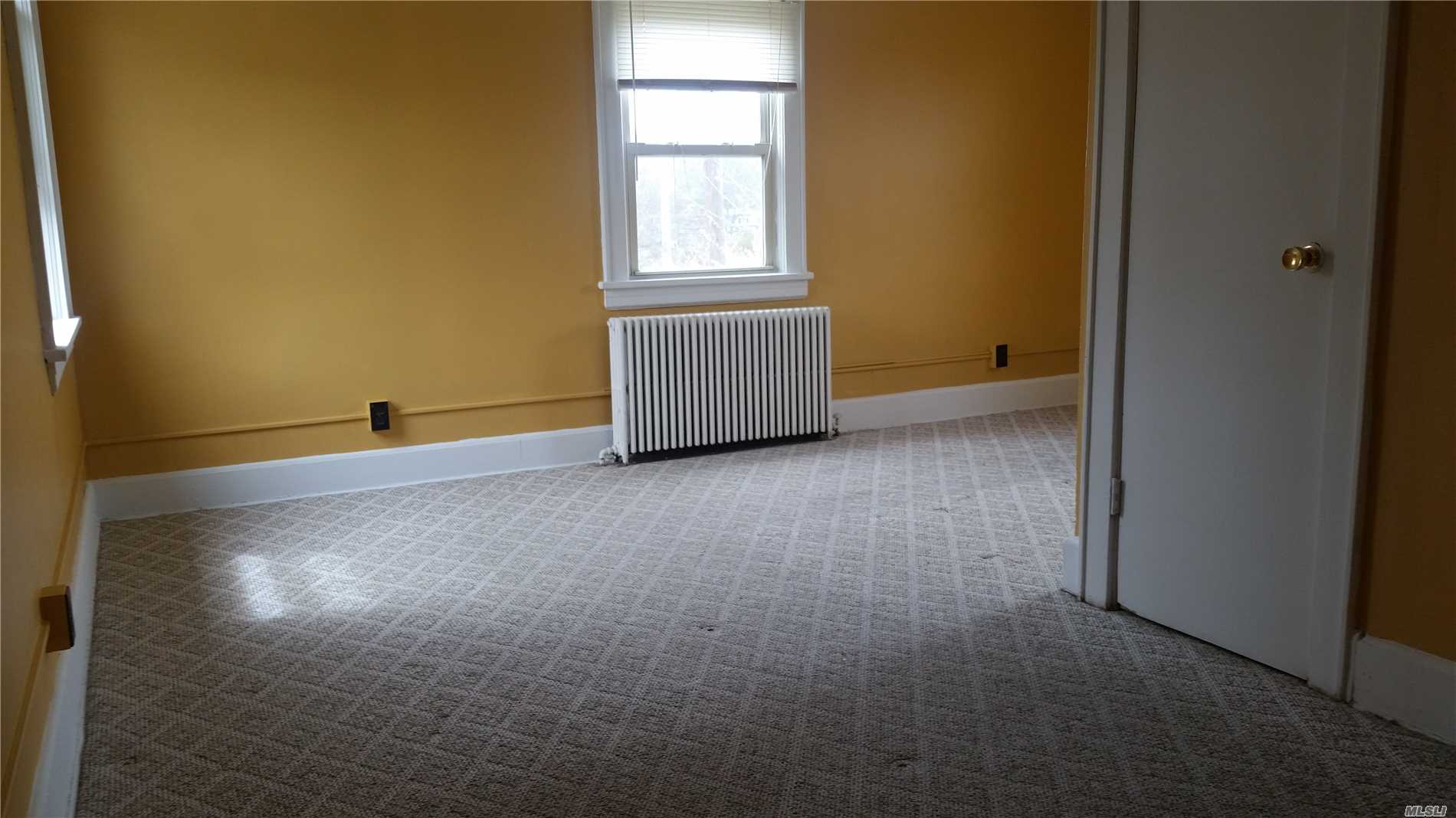 2nd floor apartment in 2-family. Lvrm, Kitchen, Bdrm and Bath. Close to shopping and food.