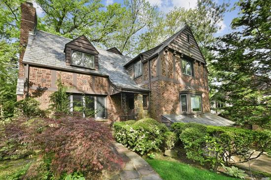 Magnificent brick Tudor in prime location! This unique gem features lots of original character and many updates, and is nestled on a private, 8, 335 Sq Ft lot with 4 bedrooms, 2.5 baths and oversized 2-car garage on a wide, tree-lined street.This house Also offers lovely sunroom with new sliding doors to the shady deck. Surrounding mature trees and plantings lend a feeling of being tucked into the woods, while still convenient to all the urban amenities for shopping, dining, schools and transp.