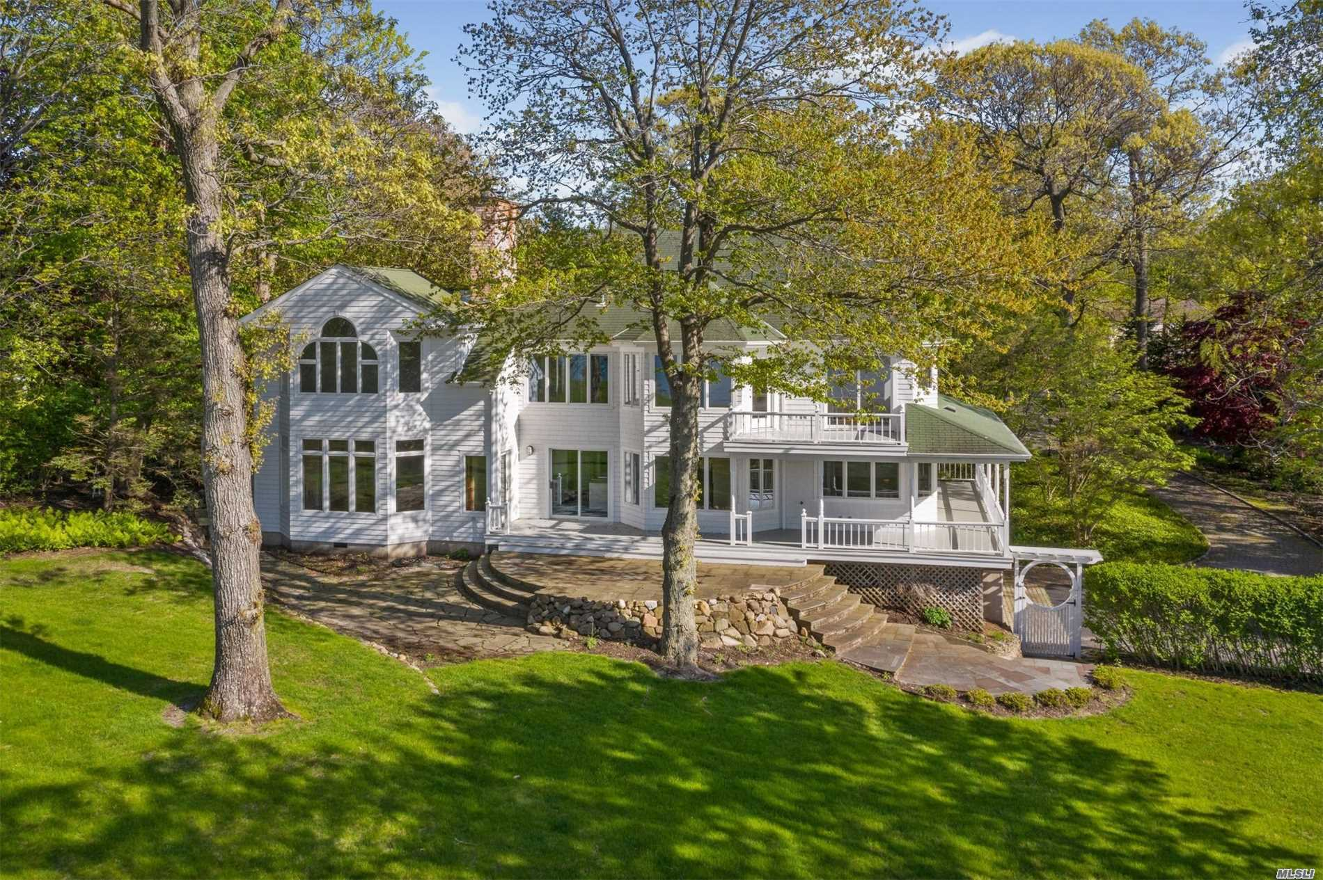 Everyday can feel like vacation! Stately 1.75 acre property set high above the Long Island Sound on a bluff offering panoramic views of the Long Island Sound to Connecticut from almost every room of this 4 bedroom Colonial. A Stairway leads directly to beach for easy access. Hardwood floors, finished basement, 2 car garage, bluestone patio, central vac, in-ground sprinklers, recessed lighting, custom millwork, oversized Andersens, pocket doors, & wrap around covered porch.