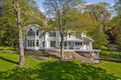 Everyday can feel like vacation! Stately 1.75 acre property set high above the Long Island Sound on a bluff offering panoramic views of the Long Island Sound to Connecticut from almost every room of this 4 bedroom expanded Colonial. A Stairway leads directly to beach for easy access. Hardwood floors, finished basement, 2 car garage, bluestone patio, central vac, in-ground sprinklers, recessed lighting, custom millwork, oversized Andersens, pocket doors, & wrap around covered porch.