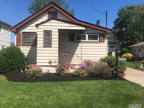 large property, charming house on tree lined block, with garages, patio and much more