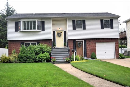 Huge Wide Line Hi-Ranch New windows updated kitchen an Baths, Hardwood Floors Thru-out, Mbr w/Full Bath. This Light and Bright Home Has An over size Property. O.S.E. Possible M/D w/Proper Permits.