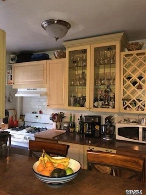 Welcome to Woodside/Astoria Border! Tastefully Renovated 1 Bedroom/1 Bath in desirable Boulevard Gardens complex. This Garden facing unit offers a Spacious Living Rm/Dining Area, Reno Eat-in-Kitchen with HW Cabinets and updated Appliances including a Dishwasher, Large Bedroom w/2 Windows, Reno Bathroom w/Subway Tiles, Wood Floors, Generous Closets. Low Maintenance includes all utilities including Electricity. Laundry Room, Bike Storage, Private Garden w/Playground/Sprinklers. Walk to M, R Train