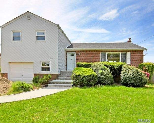 Split Style Home. This Home Features 4 Bedrooms, 2.5 Baths, Formal Dining Room, Eat In Kitchen & 1 Car Garage. Centrally Located To All. Don't Miss This Opportunity!