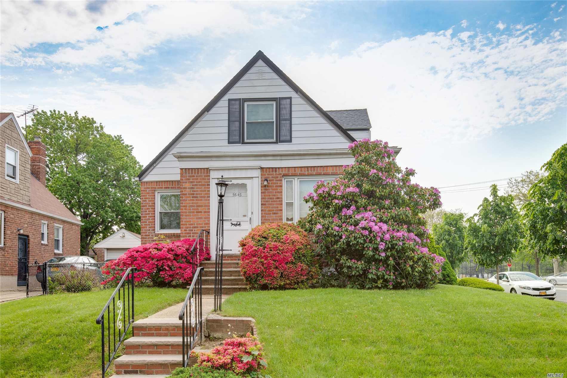 This beautifully landscaped corner cape is a must see!! Eat in kitchen, spacious living room, updated bathroom, four bedrooms. Finished basement. Roof approx. 6 years old. Boiler approx 2 years old. Private yard and rare two car garage! House is being sold as is.