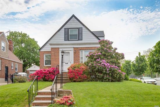 This beautifully landscaped corner cape is a must see!! Kitchen with dinette area, spacious living room, updated bathroom, four bedrooms. Finished basement with OSE. Roof approx. 6 years old. Boiler approx 2 years old. Private yard and rare two car garage!  Well maintained, move in condition.