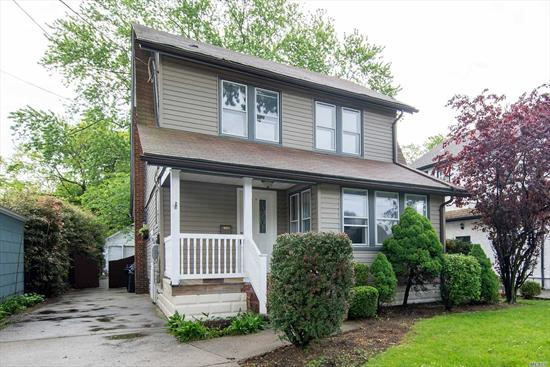 Updated Colonial in Lovely Lynbrook! 4 Bedrooms, 2 Full Bathrooms Plus A Full Finished Attic. 1st Floor Has Living room with an Enclosed Porch That Can Be Used As A Small Office. Beautiful New Kitchen Cabinets and Appliances, Full Basement With Separate Entrance Waiting To Be Finished and Personalized. Large Spacious Deck Perfect For Entertaining Overlooks Luscious Backyard.