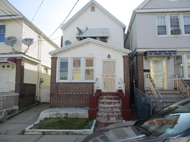 Detached two family with private driveway and garage. Large rear yard . Walking distance to shopping and transportation