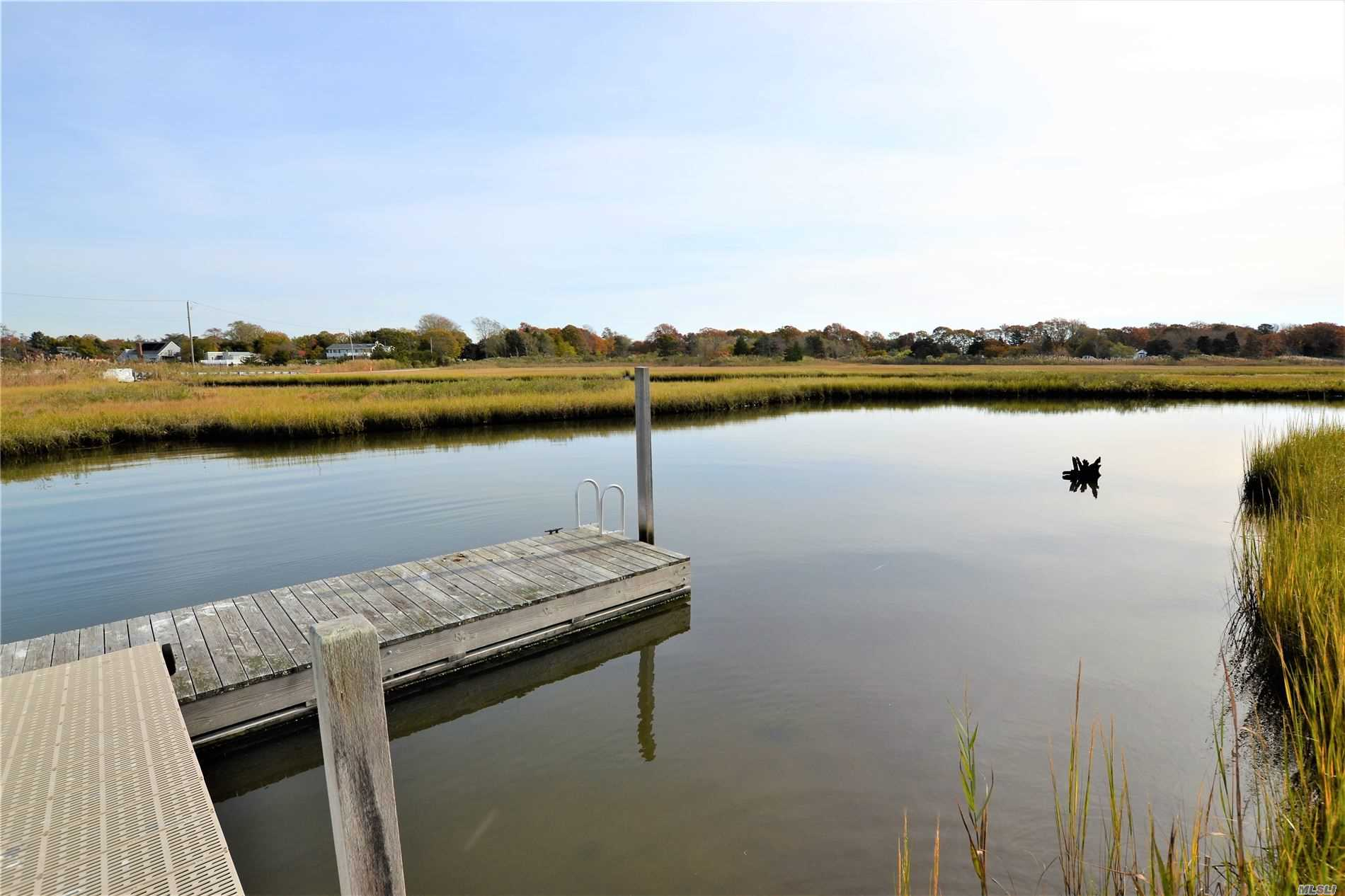 Your private waterfront estate awaits to make it your own. 2.3 acres of waterfront property on the canal w/private dock. Perfect for kayaking or paddle boarding. Potential water views with clearing. Cathedral ceilings, Open Floor plan. Great Rm w/FP, EIK. Sliders to deck w/Inground heated pool w/new liner. Outdoor Shower. 3 BR/3 full ba main floor. 2nd story MB Suite w/Private deck, MB Bath w/soak jet tub, shower, bidet, his/her sinks, Dressing area. 7 skylights allow for ext. nat. light.