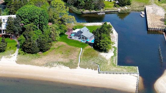Bay Front! Unobstructed views of Peconic Bay from this beautiful, well-maintained 3 bedroom, 2.5 bath home. Sited on 1.7 breathtaking acres, this property offers an in-ground swimming pool, over 200 ft of private sandy beach, 660 ft of protected canal-front, newly replaced composite bulkhead with floating dock giving the ability to dock multiple boats & water toys. The opportunity to expand the current home to 6000 sq.ft. makes this oasis the perfect choice!