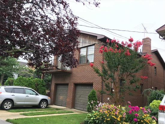 Spacious High-Ranch with Unfinished Basement OSE. Lower Level: dweling-1 bedroom - Laundry Room - 2 car garage. Upper Level: 3BR, 2 BTH (1 ensuite with MB), L-shaped living Dinning, Kitchen, wood burning fireplace, Balcony. Hardwood Floors. Spacious bedrooms.