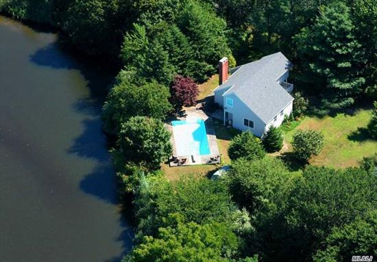 Impeccable Home on the water. In-ground pool, hot tub. Master Suite- Three bedrooms, two full baths in all. Kayak on private lake walk to sandy bay beach, playground, and close to town. Home affords lots of privacy. A fabulous summer rental. Cleaning and utilities not included.