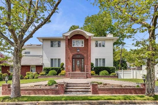 Mint condition 5 bedroom, 4 bath colonial in top location in North Woodmere SD#15 with double lot (13, 372sf), low taxes, gorgeous in-ground pool, full finished basement and much more.