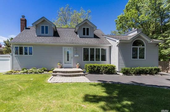EXPANDED CAPE in Cul de Sac - 4 Bedrooms, 3 Full baths, features new Furnace, New 200 amp Electrical Service, Central Air, Gas Heat, and Cesspool serviced in 2018, Granite countertops in Kitchen, Wood floors, & a large Deck & inground sprinklers