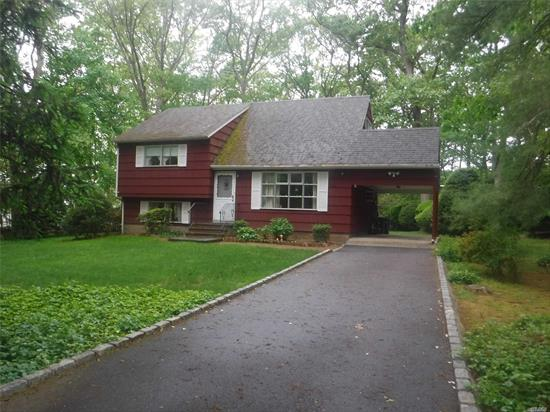Large Split/ one acre property / updated electric, roof, heating system/1.5 baths/Hard wood floors/Close to Northern State Parkway/Close to Huntington Village S. Huntington SD/Carport/ Very private home.