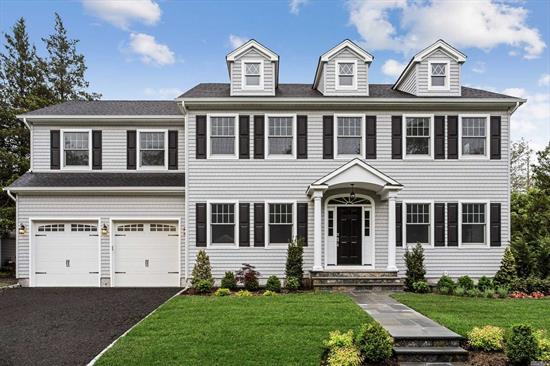 This gorgeous brand new home combines the timeless appeal of a center hall colonial w/the desired contemporary interior layout & boasts 3600 square feet of living space on the first & second flrs. Features LR w/fp, FDR w/bp, expansive FR w/fp completely open gourmet kit w/island & eating area. Sec fl mbr suite w/wic, 4 addl Brs, hall bath & lndry. Huge walk up attic, new foundation provides 9 ft bsmt ceilings & 2 car attached garage. Proximate to town & Lirr. Make this your dream home.
