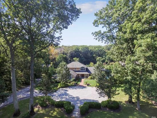 Exceptionally Built Hampton Style Stunner On Quiet Street Abutting Country Club. Light Filled, Open Floor Plan w/Gourmet Kitchen & Entertaining Spaces. Master Bedroom Sanctuary & Bath Suite, 3 Additional Bdrms, 3.5 Bths. Swimmers/Tri-Athletes' Dream. Indoor Exercise Rm W/Resistance Pool, Sprawling Entertainment Area W/Heated Pool and outdoor shower, Pavilion & Newly Finished Pool House . Large Family Rm/Executive Office Suite W FP & Built Ins. Manicured 1 Acre Lot W/3 Car Garage.