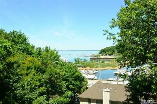 Gorgeous Townhouse Apartment Overlooking Hempstead Harbor With Magnificent Views. Completely Renovated In 2015-16. All New Baths, Kit, S/S Appliances. Must See! Decks on Every Level!